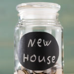 jar with coins to save downpayment for new house